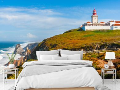 The lighthouse in Cabo da Roca. Cliffs and rocks on the Atlantic ocean coast in Sintra in a beautiful summer day, Portugal