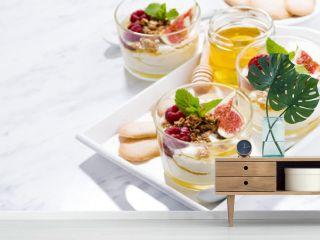 sweet greek yogurt with honey and fresh figs on white table