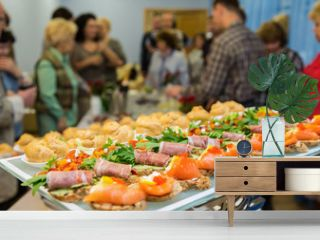 The people at the Banquet. Delicacies and snacks on the festive table. Catering