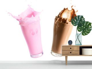Strawberry milk and chocolate milk splashing out of glass., Isolated white background.