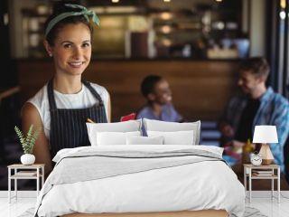 Waitress taking order at restaurant