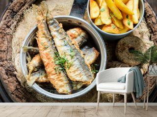 Delicious herring fish and chips with herbs and salt