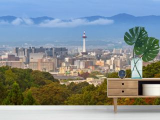 Cityscape of Kyoto with tower and autumn trees in Japan