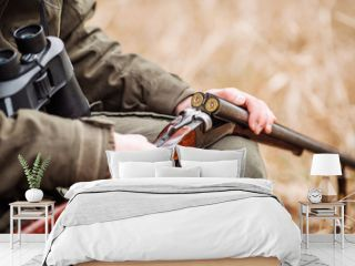 hunter loading rifle in a winter forest. Bushcraft, hunting and people concept