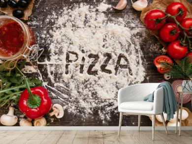 Cooking Pizza. Pizza ingerdients on the wooden table, top view