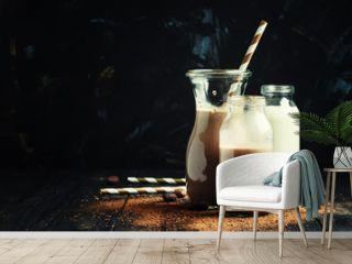 Chocolate milk in bottles, selective focus