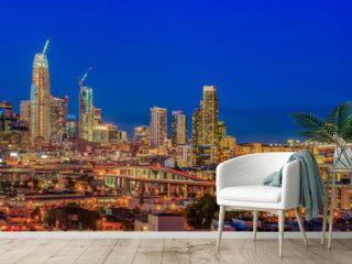 San Francisco skyline panorama with city lights, the Bay Bridge and trail lights