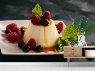 Italian dessert - panna cotta with berries and caramel sauce.