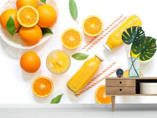 Variety of orange juice in bottles and glasses, straws, oranges isolated on white background top view.