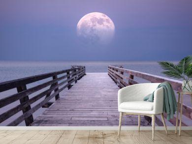 Full moon and viewpoint platform at sea dusk