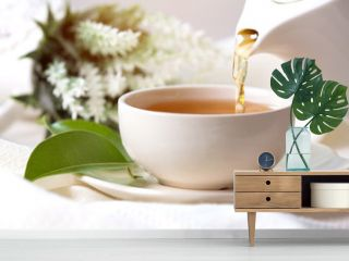 Close up pouring hot black tea in a white tea cup ,  Tea ceremony time concept