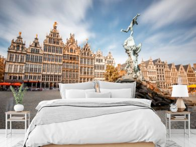 Wide angle view on the Grote Markt square with Brabo fountain in Atwerpen city, Belgium. Long exposure image technic with motion blurred people and clouds