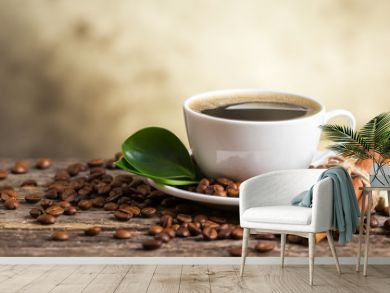 Coffee cup and saucer on a wooden table. Dark background