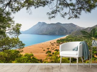 Aerial panoramic view of one of the most beautiful beaches in the world and Turkey - Cirali or Chirali near Antalya, surrounded by majestic mountains and the Mediterranean Sea