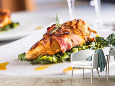 Chicken grill breast. Chicken roasted breast with bacon and spinach on white plate. Culinary food  in hotel pub or restaurant