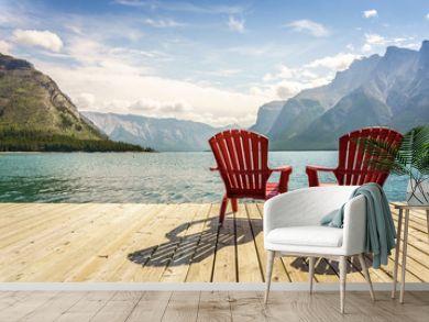 Jetty with chairs by Minnewanka Lake, Alberta, Canada
