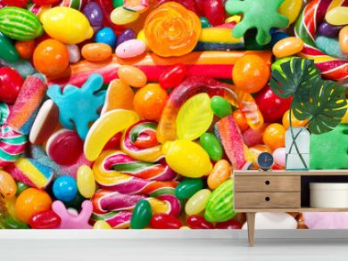 Various colorful candies, jellies, lollipops and marmalade