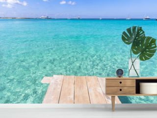 Sea wooden pier and transparent water