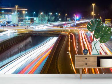 car traffic at night in neu-ulm, germany