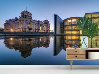 The famous Reichtsag and the Paul-Loebe-Haus at the river Spree in Berlin at dawn