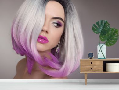 Ombre bob blonde short hairstyle. Purple makeup. Beautiful hair coloring woman. Fashion Trendy haircut. Blond model with short shiny hairstyle. Concept Coloring Hair. Beauty Salon.