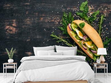 Burger, sandwich with quail egg, cucumber and corn. On a wooden background. Top view. Copy space.