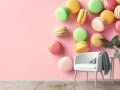 Colorful french macarons on pink background