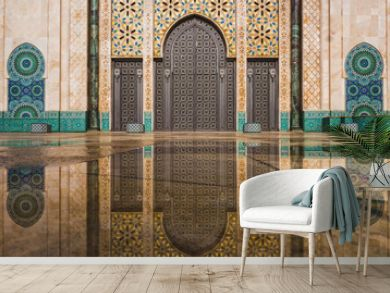 view of Hassan II mosque's big gate reflected on rain water - Casablanca - Morocco