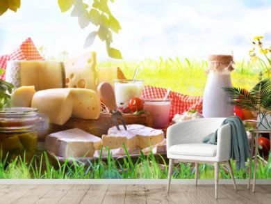 Assortment of dairy products on grass in the meadow
