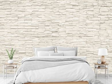 Rock stone brick tile wall aged texture detailed pattern background in cream beige brown color