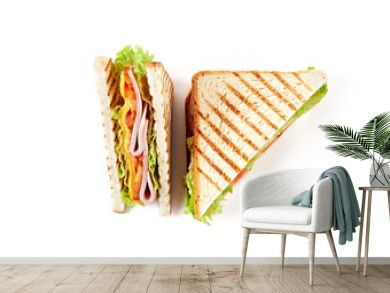 Sandwich with ham, cheese, tomatoes, lettuce, and toasted bread. Top view isolated on white background.