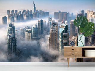 Dubai skyline, an impressive aerial top view of the city in Dubai Marina on a foggy day