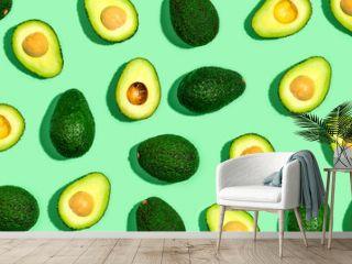 Fresh avocado pattern on a green background flat lay
