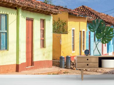 Panorama of colorful houses in a paved street of Trinidad, Cuba
