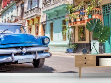 Vintage classic american car in a colorful street of Havana, Cuba. Panoramic travel photography.