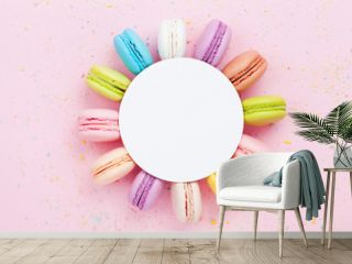 Mockup with colorful macaron or macaroon on pink pastel background top view. Flat lay composition.