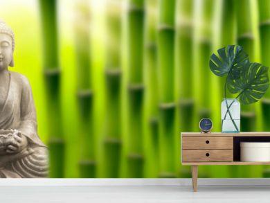 buddha in sunshine in the bamboo garden