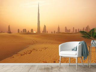 Dubai city skyline at sunset seen from the desert