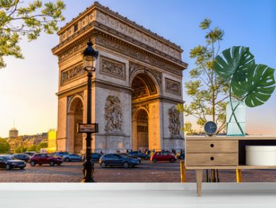 Paris Arc de Triomphe (Triumphal Arch), place Charles de Gaulle in Chaps Elysees at sunset, Paris, France.