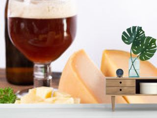 Dutch finger food usually served with glass of beer, cubes hard old cows and goat cheese with Dijon mustard