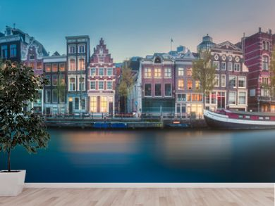 River, canals and traditional old houses Amsterdam