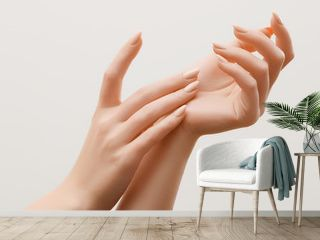 Closeup image of beautiful woman's hands with light pink manicure on the nails. Skin care for hands, manicure and beauty treatment. Elegant and graceful hands with slender graceful fingers