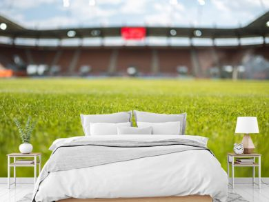 Grass with football stadium in the background.