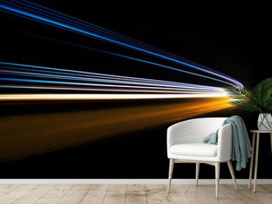 Abstract and colorful light trails in a dark tunnel. Very art image that can be used as background or texture