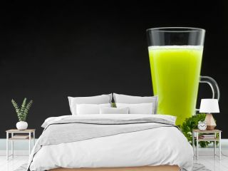 green smoothie on black background with blank space for text
