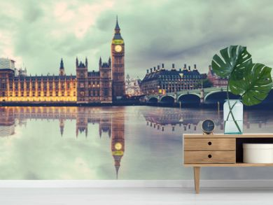 Panoramic view of Houses of Parliament, Big Ben and Westminster Bridge with reflection, London