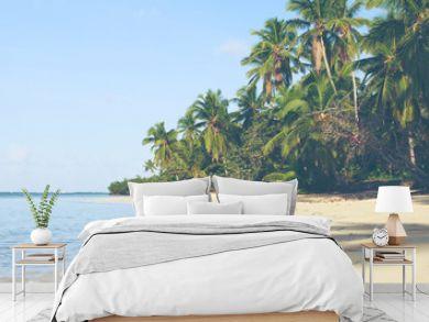 Green palm trees on caribbean beach.