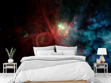 Landscape background of fantasy alien galaxy with red and blue glowing clouds and stars. The elements of this image furnished by NASA.