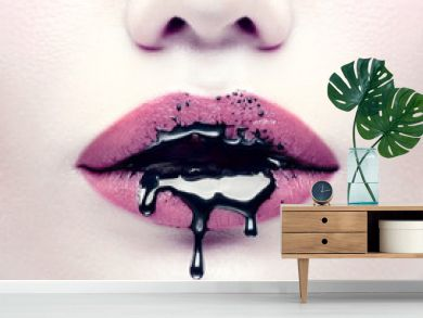 Halloween party makeup, gothic style. Black paint dripping from the lips of beautiful model girl. Beauty woman face closeup