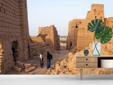 Ruined multi-storey buildings made of mud in the district of Marib, Yemen